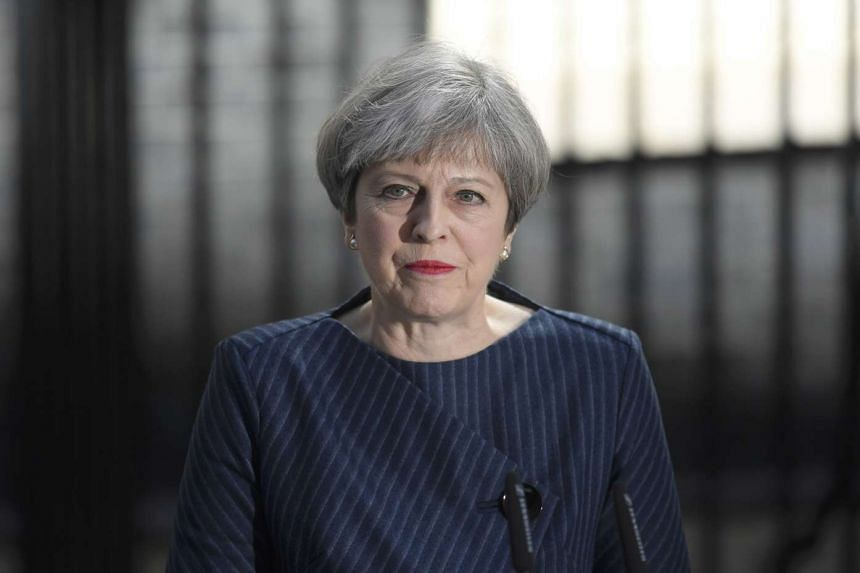 Britain's Prime Minister Theresa May speaks to the media outside 10 Downing Street, in central London, Britain on April 18, 2017.
