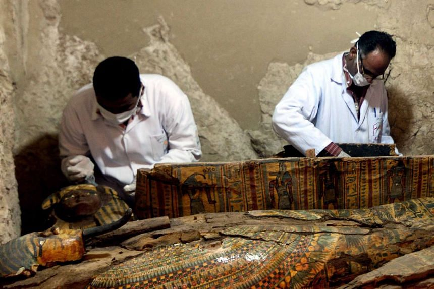 Egyptian archaeologists document the content of a recently discovered tomb at the Draa Abul Nagaa necropolis in Luxor's West Bank.
