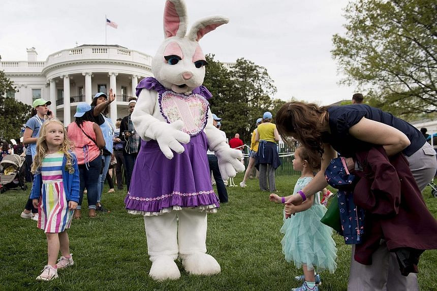 The Easter Bunny greeting attendees during the 139th White House Easter Egg Roll on the South Lawn of the White House in Washington, DC, yesterday. The annual event drew about 35,000 people last year, but this year, the White House was slow to make t