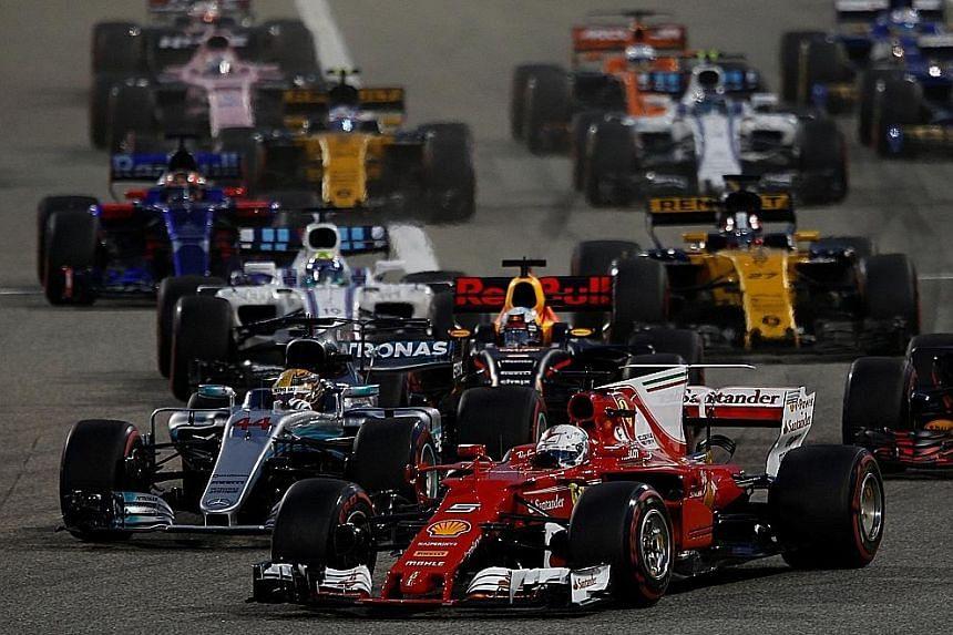 Ferrari driver Sebastian Vettel leading Mercedes' Lewis Hamilton and the rest of the pack en route to winning Sunday's Bahrain Grand Prix.