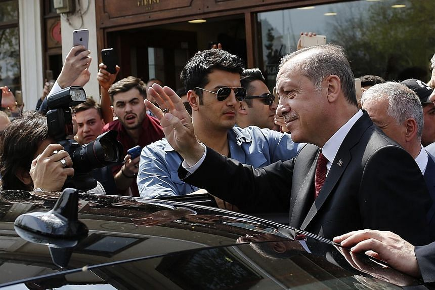 Turkish President Recep Tayyip Erdogan waving to supporters as he left Eyup Sultan mosque in Istanbul yesterday. The latest referendum was arguably his biggest ballot-box challenge since his party came to power in 2002.