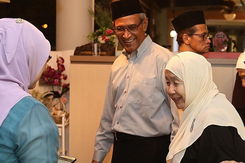 Among those at Mr Othman's wake yesterday were his daughter Lily Othman (far left), former senior minister of state Zainul Abidin Rasheed and Puan Noor Aishah.