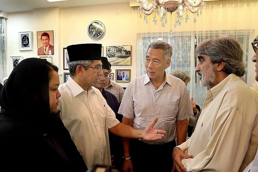 Above: Mr Othman Wok, who was 92, died yesterday at the Singapore General Hospital. Right: (From left) Mr Othman's daughter Diana, Dr Yaacob Ibrahim, Mr Othman's son-in-law Mohd Nazree Basir, PM Lee, and Mr Othman's son-in-law Munir Shah at the late