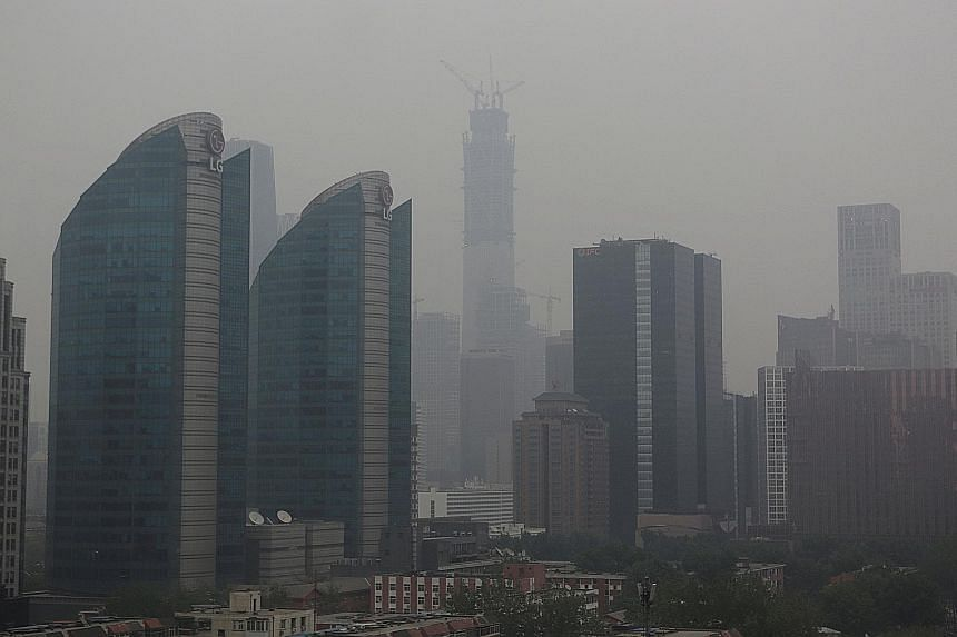 Thick haze blanketing Beijing on Sunday. It is caused by a combination of existing smog in the city and sand blown in from the Gobi Desert in Inner Mongolia.
