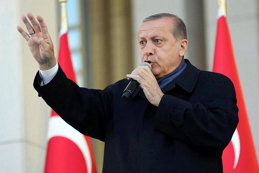 Turkish president Recep Tayyip Erdogan delivering a speech to his supporters at the Presidential Palace in Ankara, on April 17, 2017.