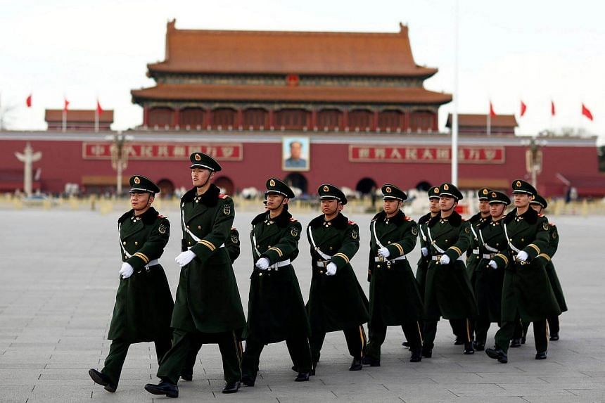 Paramilitary police walk in formation accross Tiananmen Square as the sessions of the National People's Congress are taking place in the nearby Great Hall of the People in Beijing, China on March 6, 2017.
