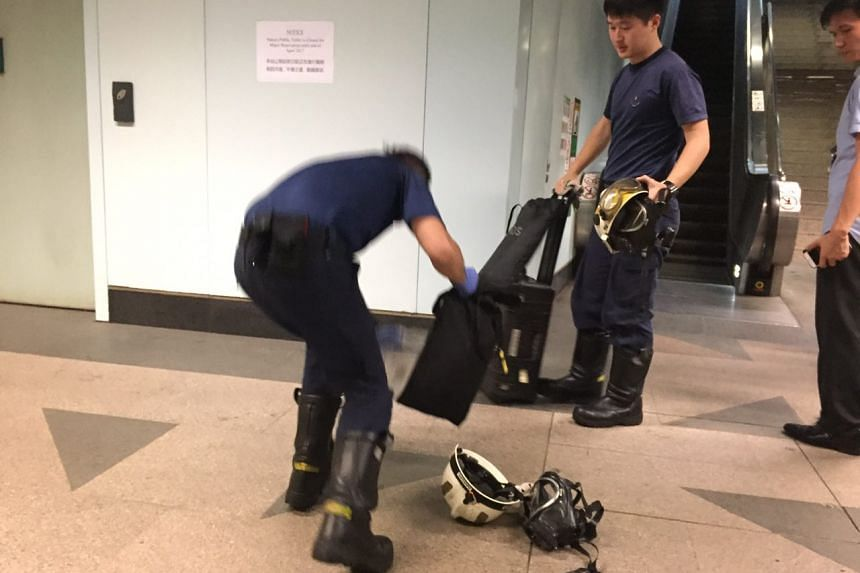 Officers from the Singapore Civil Defence Force packing up as Woodleigh MRT station reopens.