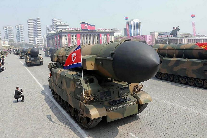 Korean People's ballistic missiles being displayed through Kim Il Sung square during a military parade in Pyongyang marking the 105th anniversary of the birth of late North Korean leader Kim Il Sung, on April 15, 2017.