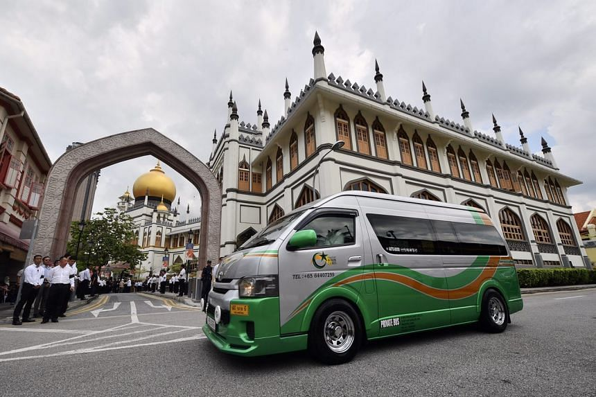 The funeral hearse of Mr Othman Wok arrives outside the Sultan Mosque on April 18 2017.