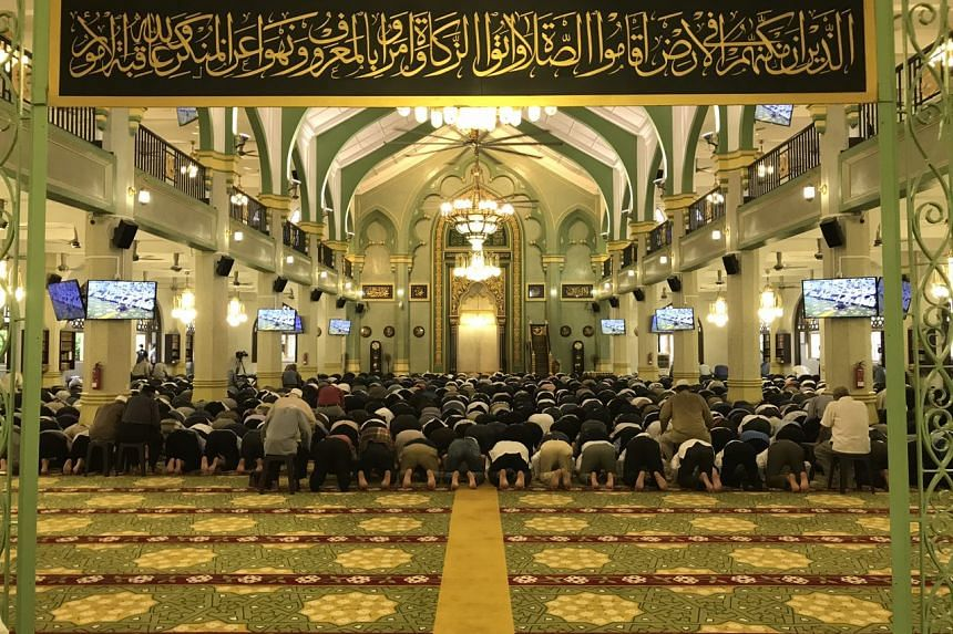 Worshipers in the prayer hall at the Sultan Mosque