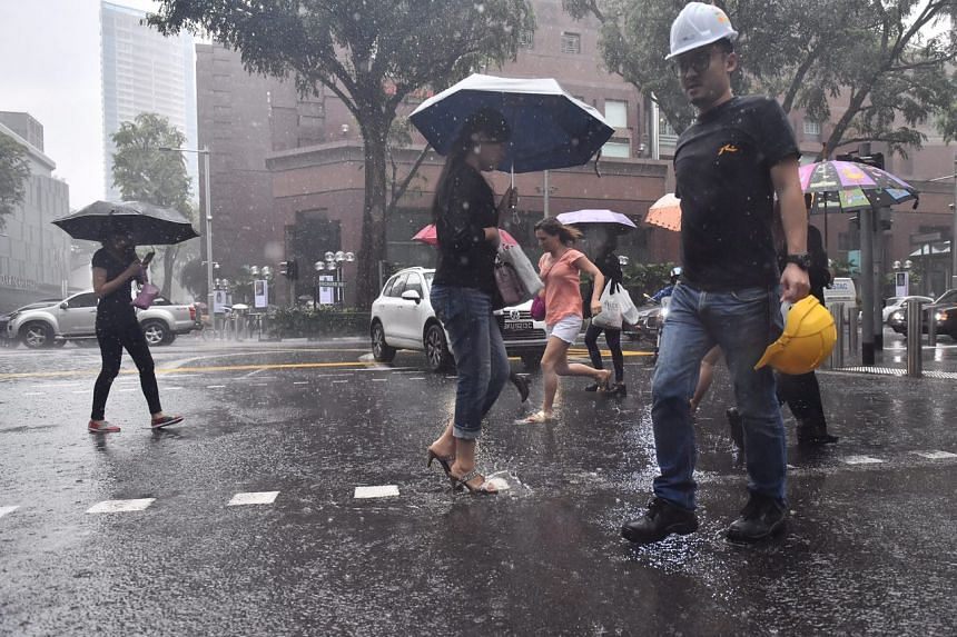 Pedestrians walking through the flood at Orchard Road.
