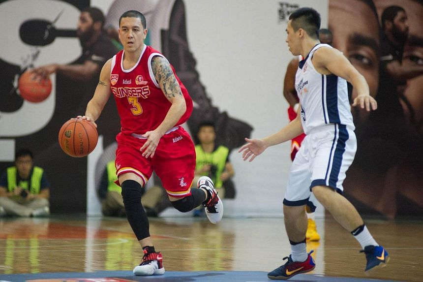 Singapore Slingers point guard Joshua Urbiztondo (in red) dribbling past Lee Ki in the 92-76 Asean Basketball League Finals Game 1 win over the Hong Kong Eastern Long Lions at the Southorn Stadium.