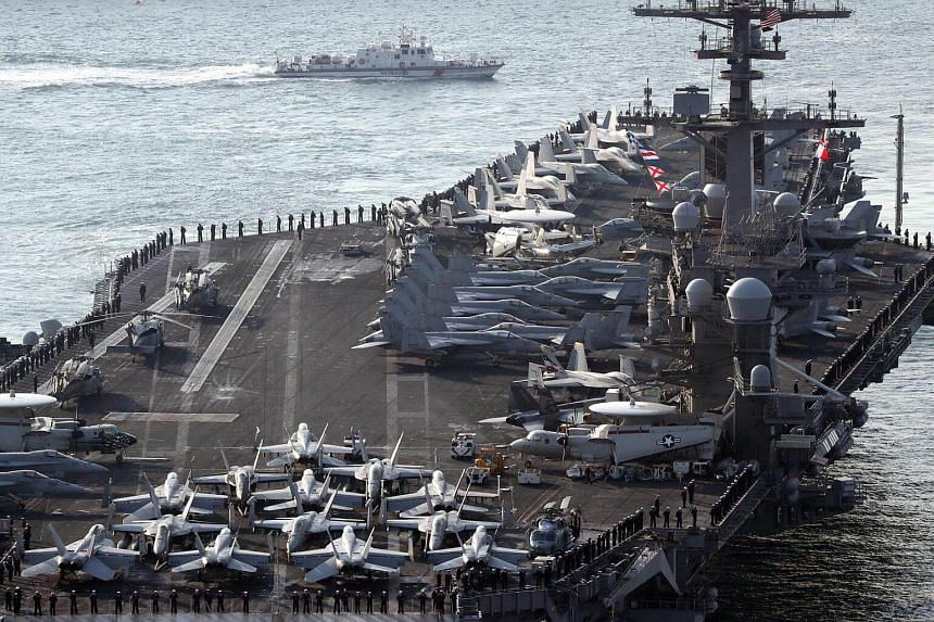 """US aircraft carrier USS Carl Vinson arriving for an annual joint military exercise called """"Foal Eagle"""" between South Korea and US, at the port of Busan, South Korea, on March 15, 2017."""