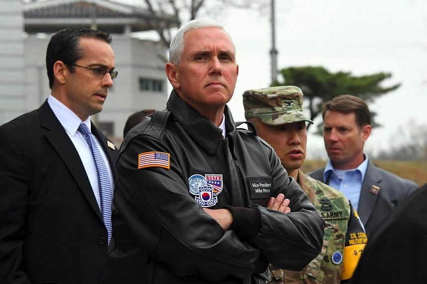 US Vice President Mike Pence (centre) visiting the truce village of Panmunjom in the Demilitarized Zone (DMZ) on the border between North and South Korea, on April 17, 2017.