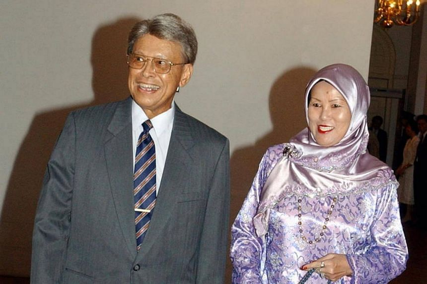 Former cabinet minister Othman Wok and his wife Lina Abdullah.
