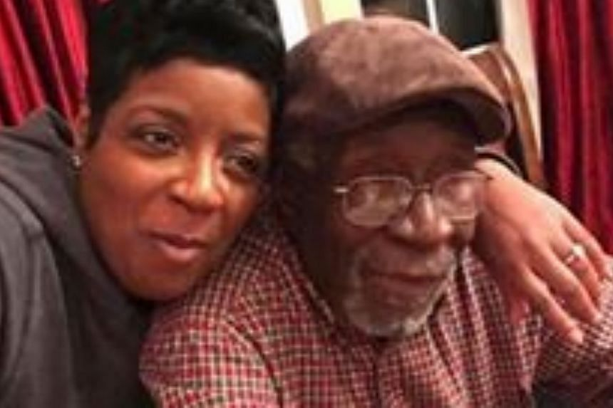Facebook killer victim Robert Godwin is seen with an unidentified woman in a photo his family said it would rather people saw on Facebook then video in which he is murdered.