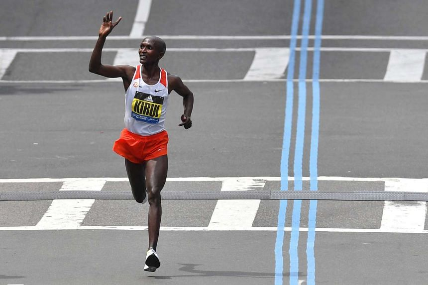 Geoffrey Kirui, of Kenya, acknowledges the crowd as he wins the men's division of the 121st Boston Marathon on Monday (April 17).