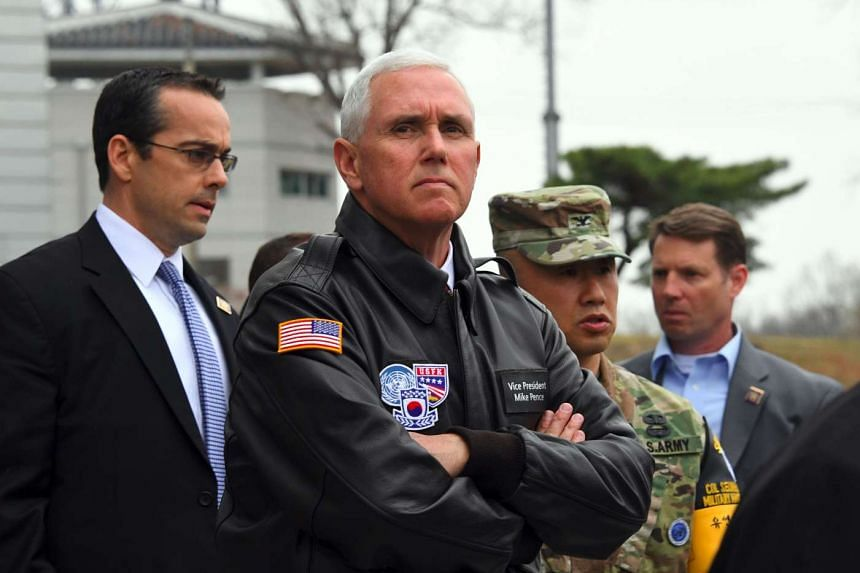 US Vice President Mike Pence (centre) visits the truce village of Panmunjom in the DMZ on the border between North and South Korea on April 17, 2017.