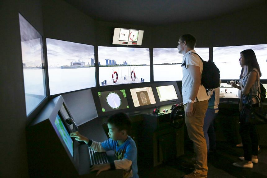 """Visitors to the refreshed Singapore Maritime Gallery at Marina South Pier can get to command a ship via a simulator, as well as go """"ship spotting"""" by pointing a tablet at the models on display. There is also a resource corner at the gallery, which underwe"""