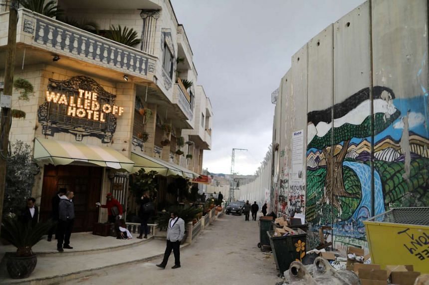 Opened more than a month ago, the Walled Off Hotel faces the West Bank separation wall.