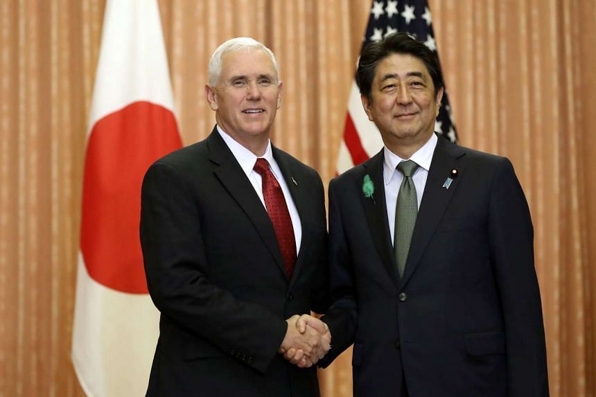 Japanese Prime Minister Shinzo Abe (right) and US Vice President Mike Pence shaking hands at the Prime Minister's official residence in Tokyo, Japan, on April 18, 2017.