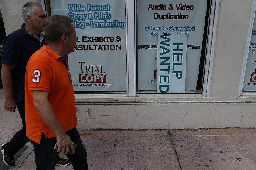 A Help Wanted sign is seen in Miami, Florida, on March 10, 2017.