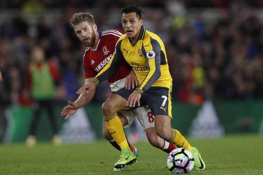 Arsenal's Alexis Sanchez (right) in action with Middlesbrough's Adam Clayton (left) during the Premier League at The Riverside Stadium on April 17, 2017.
