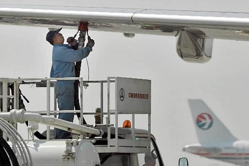 A file photo of a China Aviation Oil technician refuelling a plane at Beijing's Shoudu Capital Airport.
