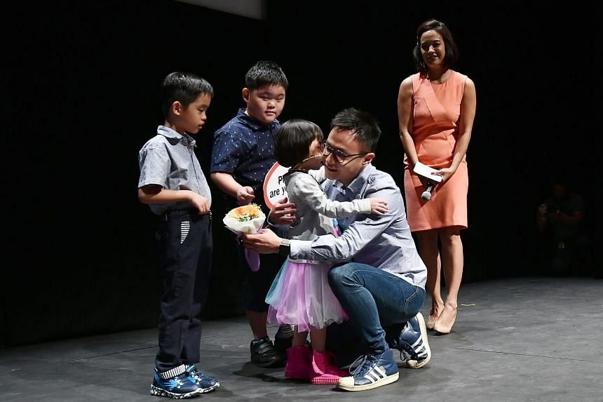 Eight-year-old Ryssa giving a hug to her bone marrow donor Phil Tan, on April 19, 2017.