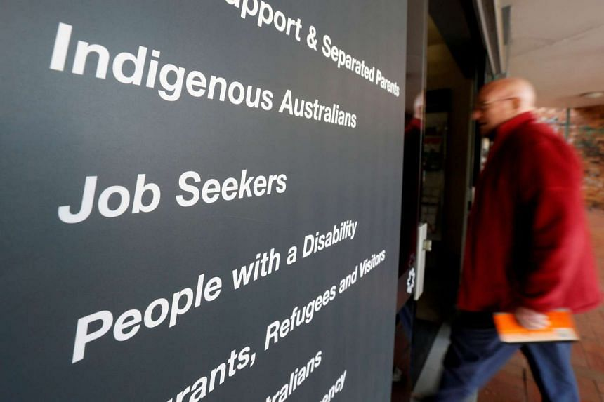 A man walks into a Centrelink, part of the Australian government's department of human services where job seekers search for employment, in a Sydney suburb, on Aug 7, 2014.