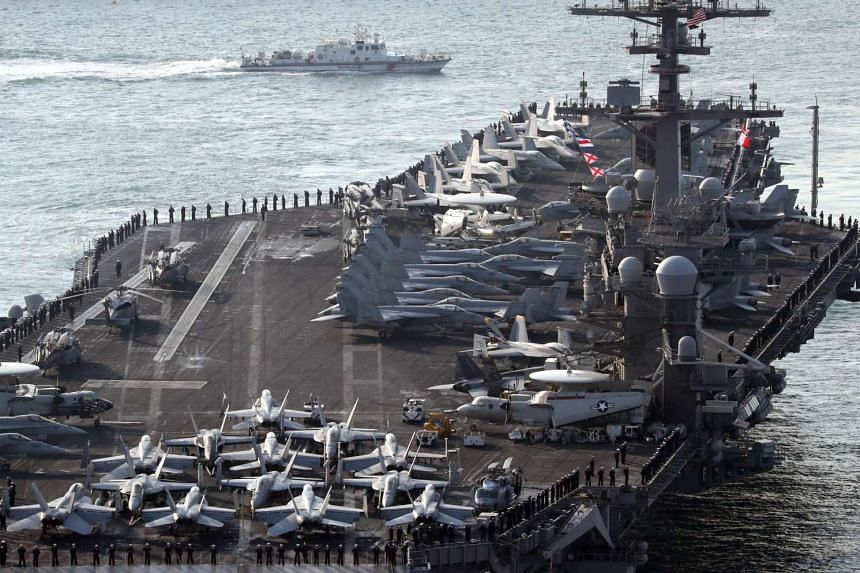 The USS Carl Vinson arrives for an annual joint military exercise between South Korea and the US on March 15, 2017.