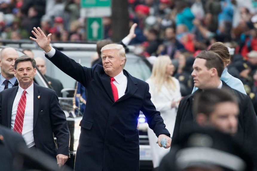 US President Donald Trump and first lady Melania Trump walking in the Inaugural Parade on Jan 20, 2017, in Washington, DC.