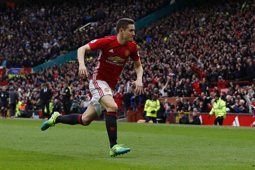 Manchester United's Ander Herrera celebrates after scoring the team's second goal in the match against Chelsea.