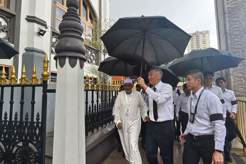 Singapore Prime MInister Lee Hsien (second from right) arrives at Masjid Sultan to pay his last respects to late Othman Wok, a member of independent Singapore's first Cabinet at a funeral prayers in Singapore on April 18, 2017.
