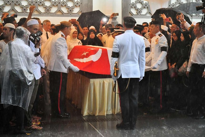 The State Flag was draped over the casket in the presence of Mr Othman Wok's family.