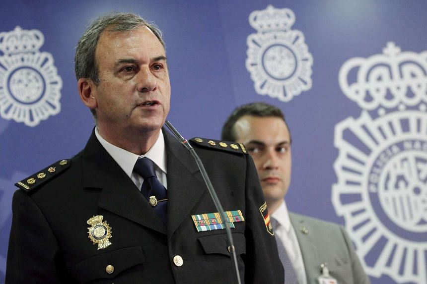 Chief of the Spanish Technological Police brigade, Rafael Perez (left), at a press conference to announce the dismantling of a child pornography network in Madrid, Spain, on Tuesday (April 18).