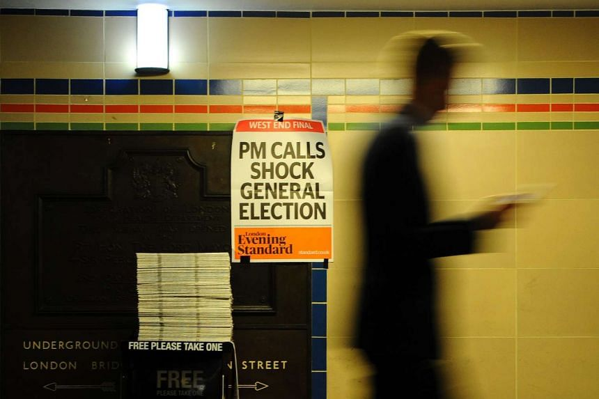 A poster above a newspaper stand advertises today's Evening Standard, with the front page story relating to British Prime Minister Theresa May's call for a snap general election on June 8, in central London on April 18, 2017.