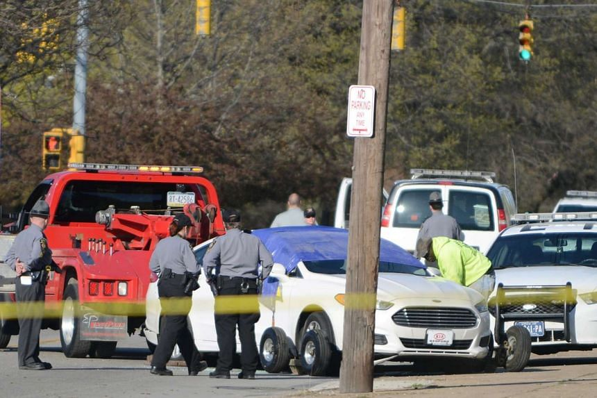 Crews remove the car of a fugitive, who police said posted a video of himself on Facebook killing an elderly man in Cleveland, after he shot and killed himself following a brief police pursuit in Erie, Pennsylvania, US, on April 18, 2017.