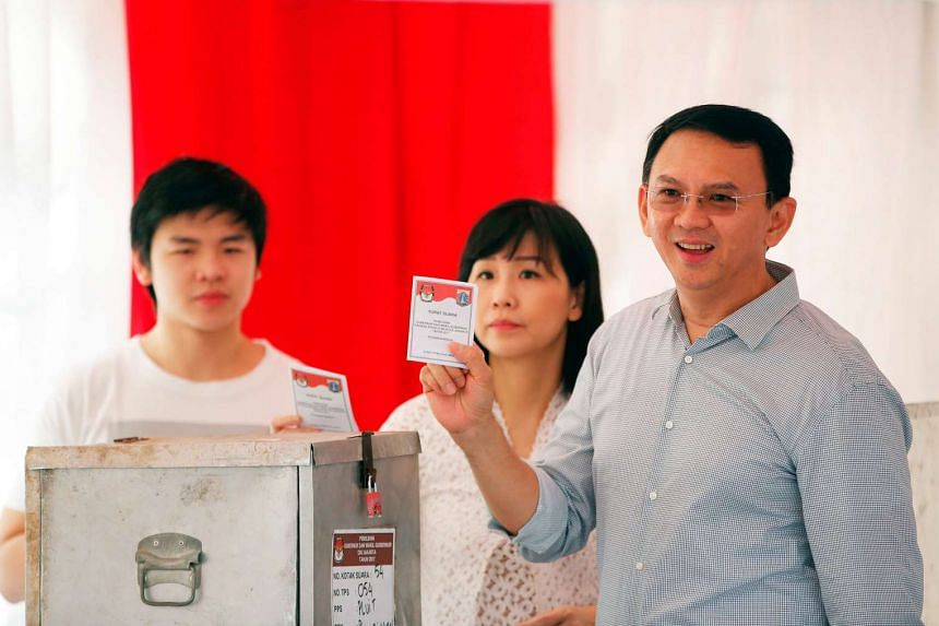 Basuki Tjahaja Purnama with his wife Veronica Tan and his son Nicholas at a polling station in North Jakarta, Indonesia, on April 19, 2017.