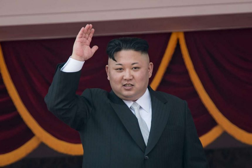 North Korean leader Kim Jong-Un waving at a military parade marking the 105th anniversary of the birth of late North Korean leader Kim Il Sung, in Pyongyang.