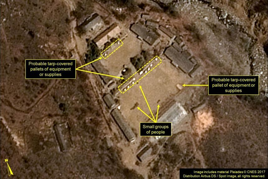 A satellite image showing North Korea's Punggye-ri Nuclear Test Site, with probable tarp-covered pallets and personnel in the Main Administrative Area.