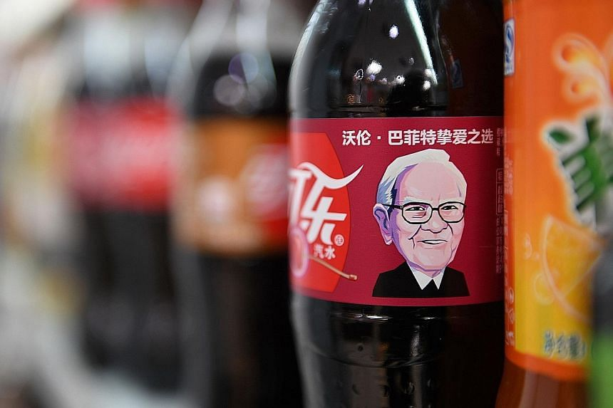 A Cherry Coke bottle featuring an image of US billionaire investor Warren Buffet, who consumes the drink often, seen on a shelf at a convenience store in Beijing.