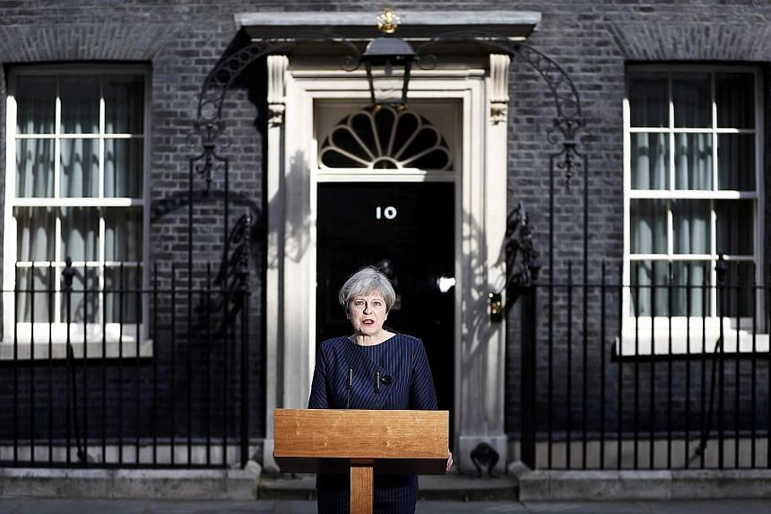 British Prime Minister Theresa May announcing the snap election outside 10 Downing Street in London yesterday.