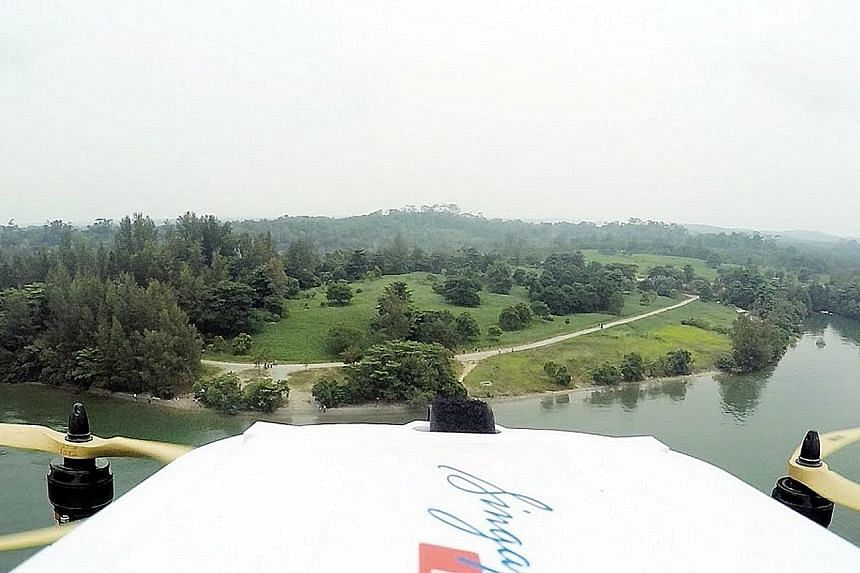 A SingPost drone during a successful delivery trial in September 2015, when it delivered a letter and T-shirt from Lorong Halus to Pulau Ubin. In the planned live test at NUS early next year, autonomous drones will fly on pre-defined routes to drop o