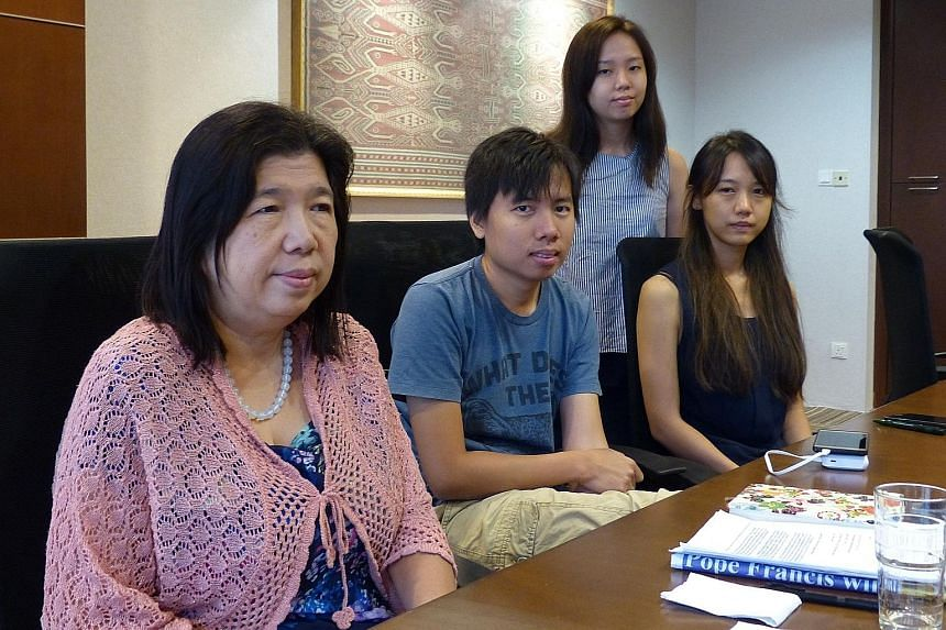 Mr Raymond Koh received a death threat in 2011 and went missing on Feb 13. His family members (from right) wife Susanna Liew, son Jonathan, and daughters Elizabeth and Ester are clinging on to hope that their patriarch is safe.