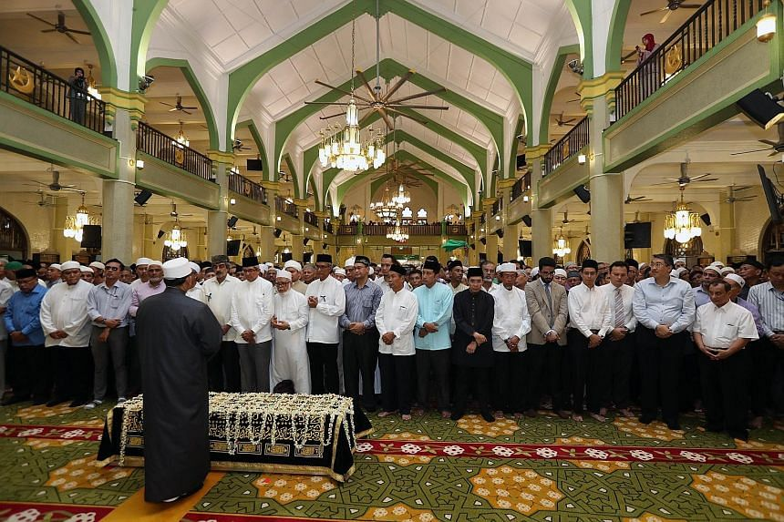 """Family members, friends and ordinary Singaporeans turned up at Sultan Mosque, where prayers were recited just after 1pm yesterday for Mr Othman Wok, who helped to """"embed"""" multi-culturalism in Singaporean lives."""