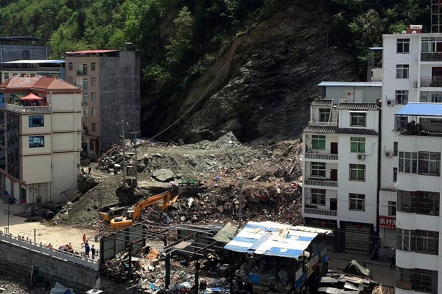 An avalanche of soil and debris swept down a hill in north-western China's Shaanxi province on Monday, flattening a seven-storey apartment building and killing three people. The landslide, triggered by heavy rains over the last weekend, forced the ev