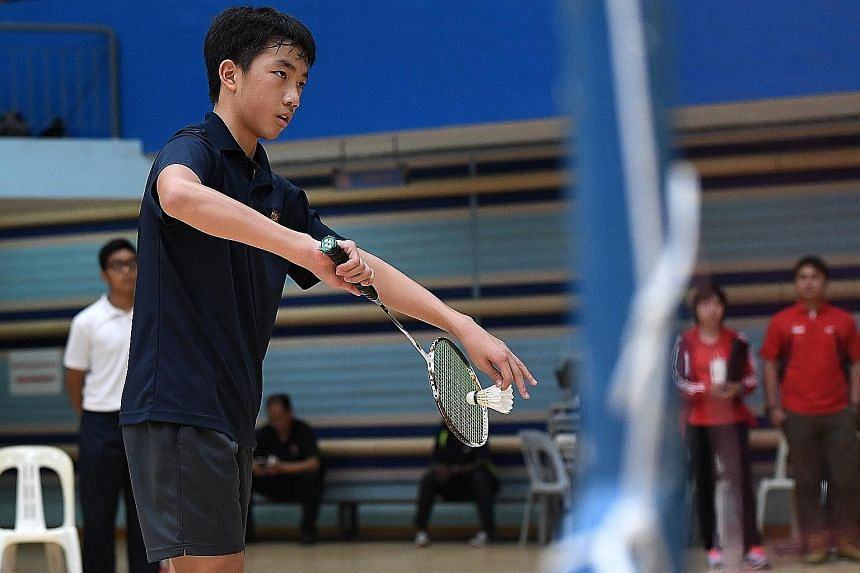 Jacob Tan, 14, captain of the Anglo-Chinese School (Independent) C Division team, preparing to serve during the first doubles match against Singapore Sports School. He and partner Kendric Cheng beat their opponents to lead their school to an overall