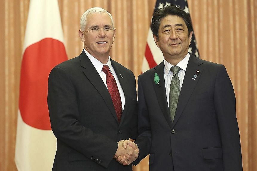 US Vice-President Mike Pence with Japan's Prime Minister Shinzo Abe in Tokyo yesterday. Mr Pence reiterated Washington's commitment to Japan's security in the face of the nuclear threat from North Korea.