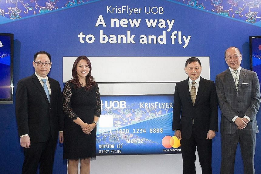 (From left) Mr Tan Kai Ping, senior vice-president of marketing planning, Singapore Airlines; Ms Jacquelyn Tan, head of personal financial services Singapore, UOB; Mr Goh Choon Phong, chief executive of SIA; and Mr Wee Ee Cheong, deputy chairman of U